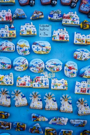 Santorini, Greece - May 5, 2014 : Typical greek ceramic magnet souvenirs representing the architectural scenes from the greek islands