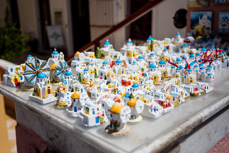 Santorini, Greece - May 5, 2014 : Typical greek ceramic souvenirs representing the architectural scenes from the greek islands