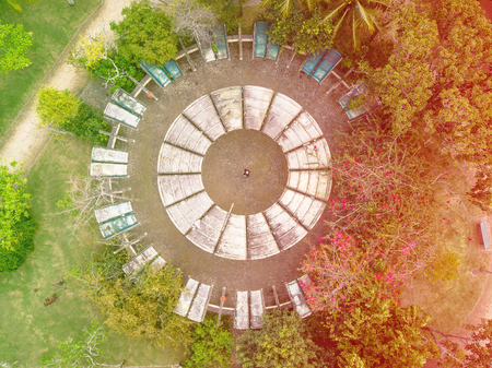 aerial view of man inside circular playground in park in Barra da tijuca, Rio de janeiro. Drone pov shows geometric shapes and patterns, including circles.