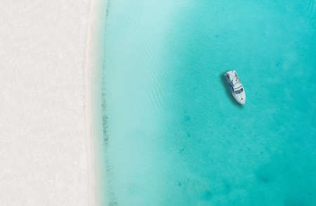 Drone photo of beach in Sapodilla Bay, Providenciales, Turks and caicos, boat by itself