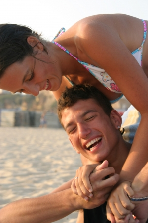 happy couple playing on the beach Stock Photo