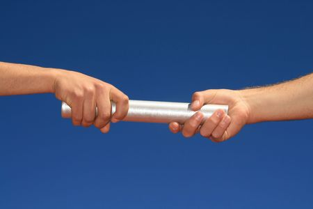 hands passing the baton