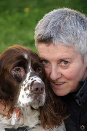 mature woman with dog in the park