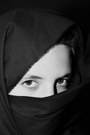 Beautiful eyes looking from above her veil photo