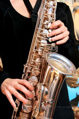 fingering: hands of musicinan playing Saxophone Stock Photo
