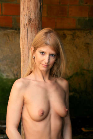 nice breast: sexy naked woman in old building