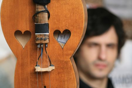 musician playing a string instrument photo
