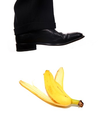 businessman shoe steping a banana Stock Photo - 3982952