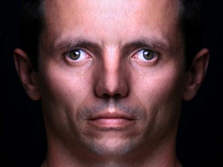 monster head portrait against black background Stock Photo