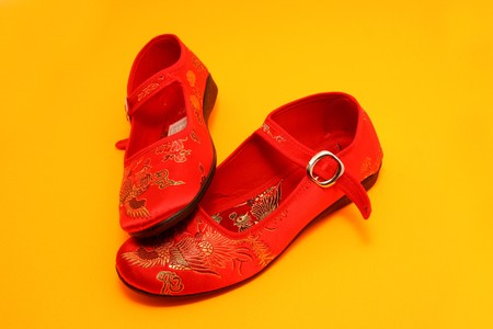 wearing sandals: red beautiful chinese oriental shoes