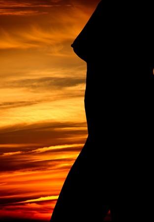 sexy woman sunset(non pornographic photo) Stock Photo - 4103739