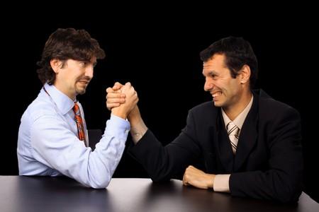 businessmans arm wrestling over white background