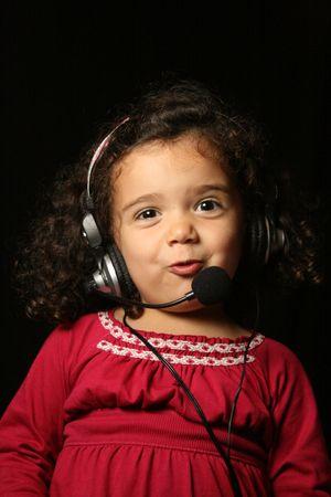 Smiling child wearing headset