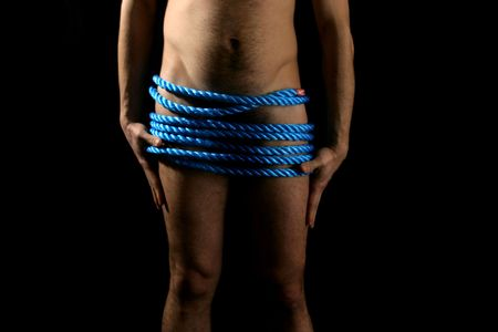 a muscular man posing artistic photo