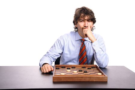 proceedings: businessman playing chess, studio photo