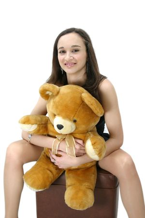 attractive and beautiful casual young woman with teddy bear Stock Photo - 5170620