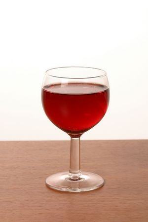glass of red wine isolated on white photo