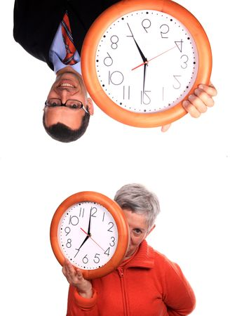 mature woman and businessman with clock over white background photo