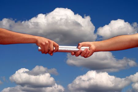 passing: hands passing the baton, business and sports theme Stock Photo