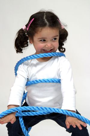 hapiness: beautiful girl playing with blue rope