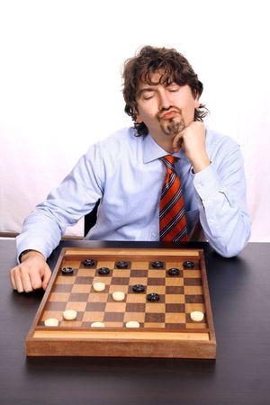 businessman playing chess, studio photo photo
