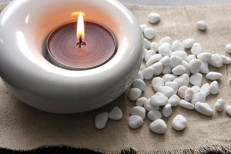 candles and massage stones in a calm zen spas photo