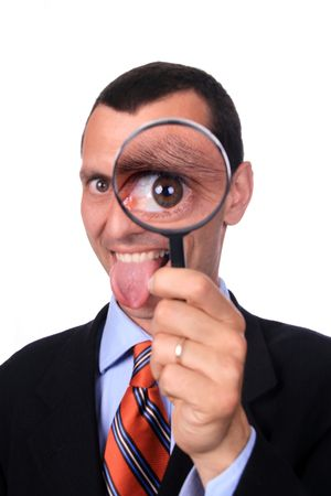 businessman with magnifying glass, isolated on white photo