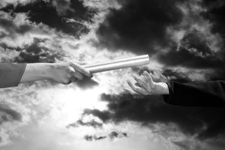 hands passing the baton, business and sports theme photo