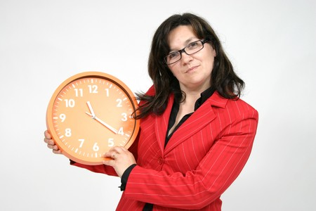 corporate waste: sexy businesswoman with clock, business photo Stock Photo