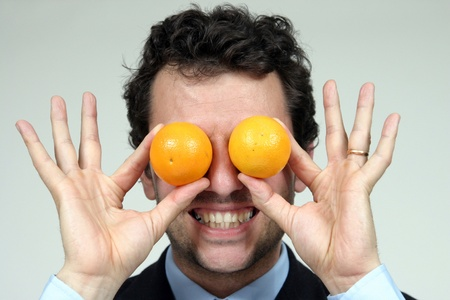 man with two oranges photo