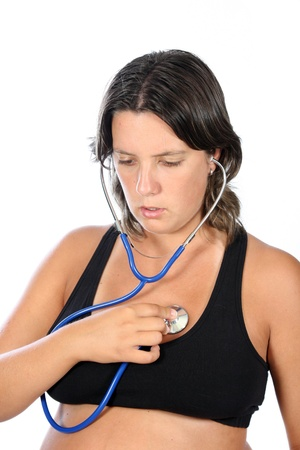 listening to heartbeat: beautiful pregnant woman being examined with a stethoscope Stock Photo