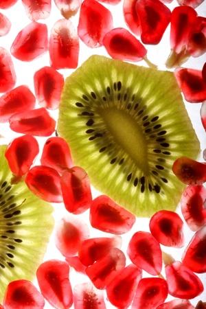 peal: beautiful and fresh pomegranate grains and kiwi Stock Photo