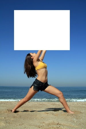 A gorgeous model holding a blank sign in the air photo