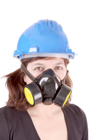 woman with safety protection, gas mask and helmet photo
