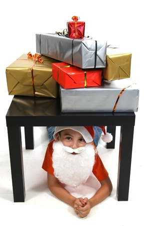 exhilarated: boy with large present at christmas time Stock Photo