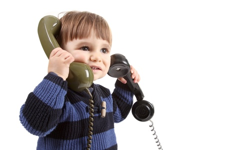 phone support: small child in a call center with two phones Stock Photo