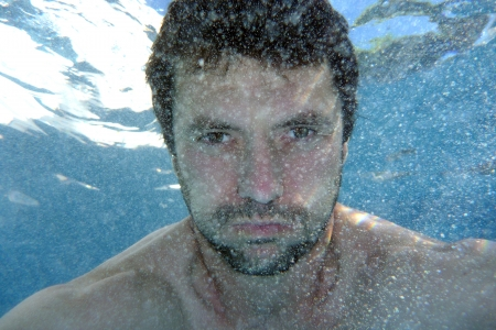 man underwater in the pool, underwater photo