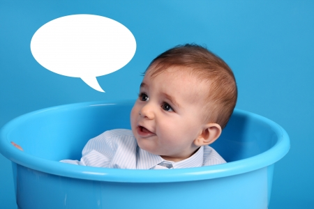 baby on a blue bucket, studio shoot, baby bubble talk photo
