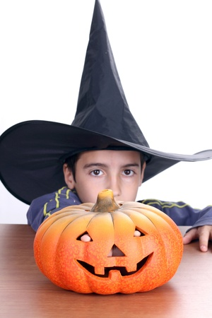 big pumpkin with black witch wizard halloween (focus on the pumpkin) Stock Photo - 16064708