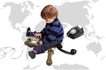 child in a call center with old phones photo