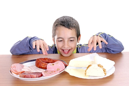 hungry boy for cheese and sausage, food photo Stock Photo - 16064736