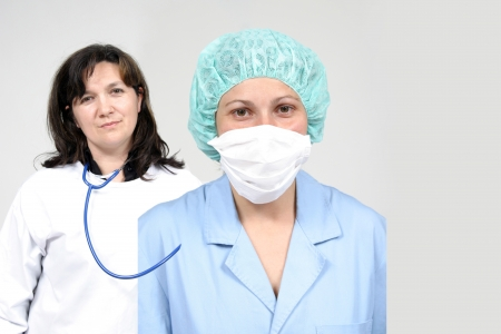 ah1n1: Doctor and nurse  isolated on grey, health photo