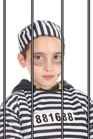 A view of a sad prisoner in jail Stock Photo - 16064738