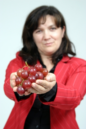 beautiful woman with red grapes, healthy food photo