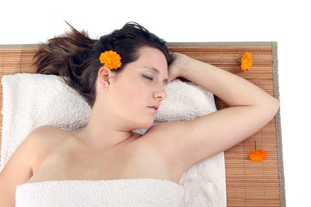 attractive woman with hot stones treatment at a spa photo