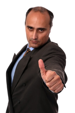 Portrait of a businessman standing against isolated white background photo