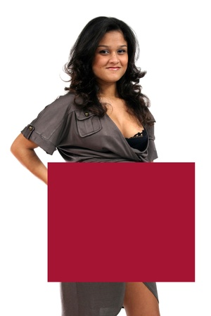 Young woman holding blank board photo
