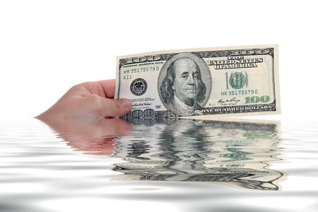 hand holding a dollar bill, business studio photo