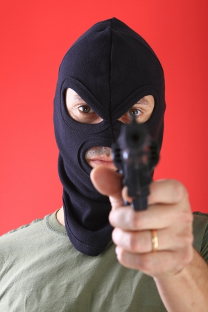 A man with a black mask, burglar photo