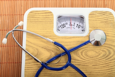 physican: stethoscope and balance symbol photo for weight control